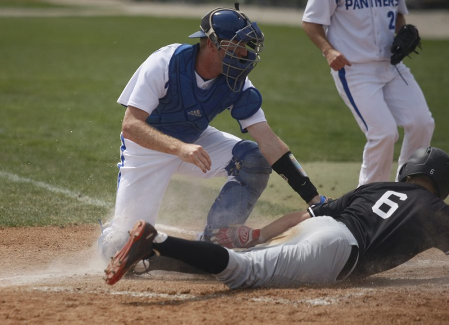 Redshirt junior catcher Justin Smith tags Southeast Missouri's Kyle Bottger out at home plate during the Panthers' game Sunday at Coaches Stadium. The Panthers lost the final game of the series, 7-6.