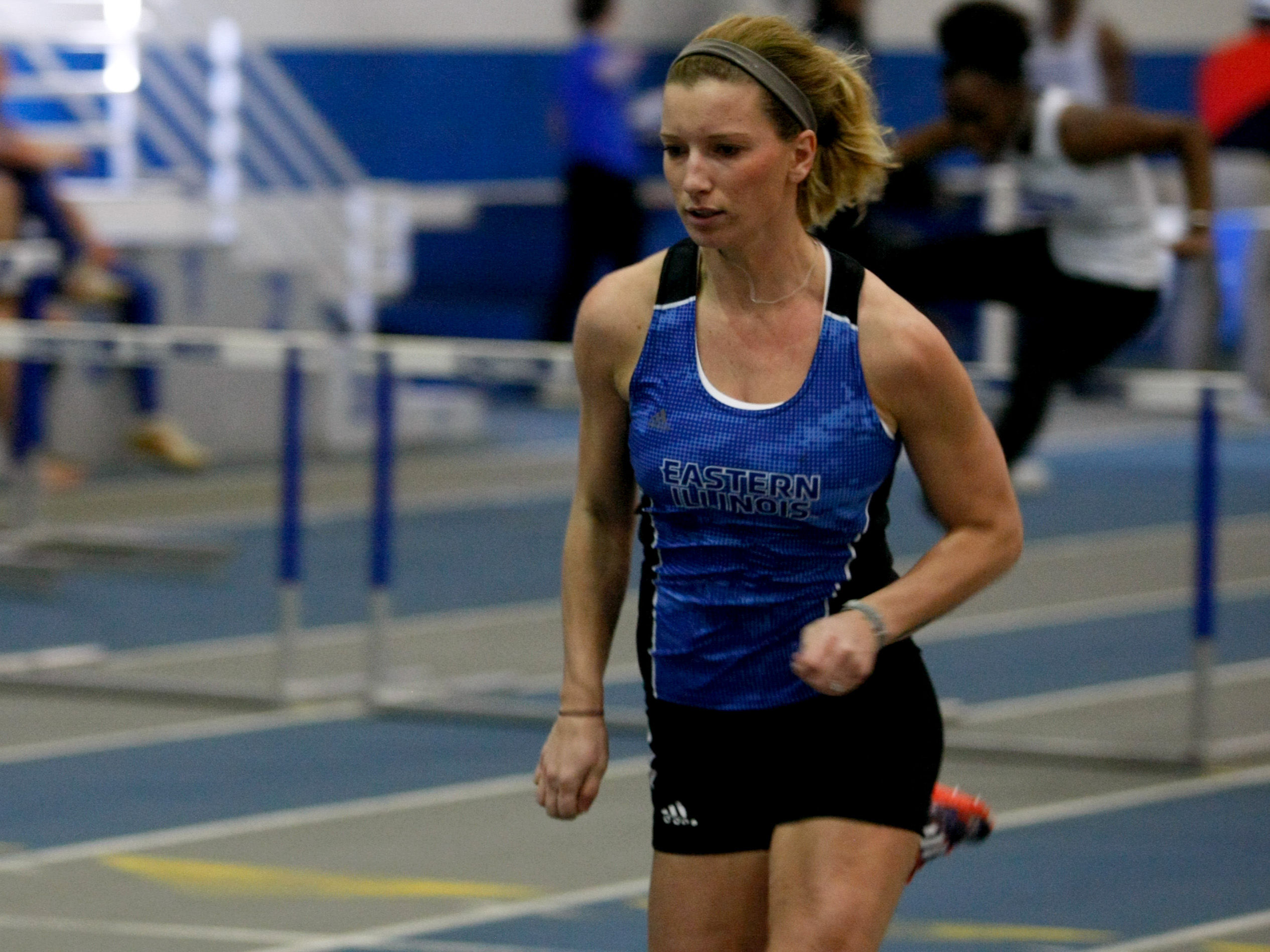Senior Tori Master competes in the hurdles at the Friday Night Special in the Lantz Fieldhouse Feb. 17.