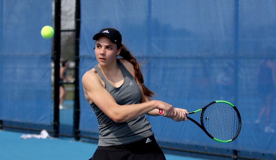 Freshman Stella Cliffe backhands the ball back to her Eastern Kentucky opponent March 24 at the Darling Courts. Cliffe picked up a win this weekend.