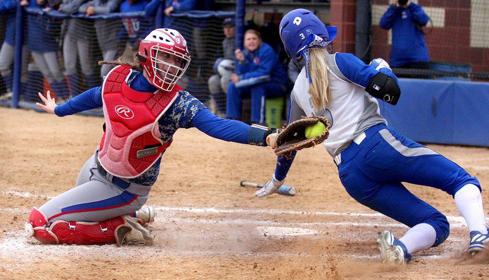 Sophomore Kayla Bear slides around Tennessee State catcher Emma Colegrove's tag at the plate in the Panthers' 9-1 win March 25 at Williams Field.