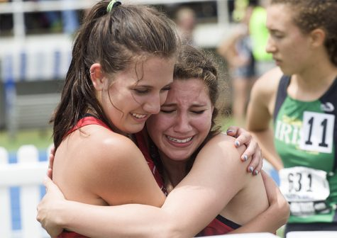 Deer Creek Mackinsaw High School Junior Mikayala Moore and Senior Annie White hug after winning the 4x800 Meter Relay race Saturday at the IHSA Girls' Track Meet.