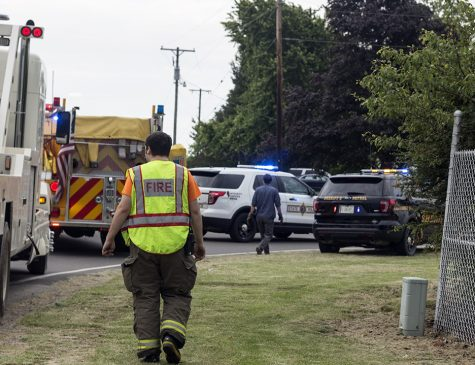 Police cars and fire engines surround the scene of an accident Tuesday afternoon.