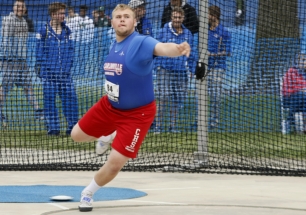 Daniel Card, a junior from Carlinville High School, competes in the class 1A discus throw Thursday at O'Brien Stadium during the preliminary rounds of the IHSA boys track meet.