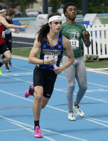 Josiah Vogel, a junior from Rockford Christian high school, competes in the class 1A 400x200-meter relay Thursday during the preliminary rounds of the IHSA boys track meet at O'Brien Stadium.