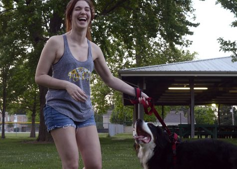 Emily Suslee, a Charleston resident and student at Lakeland College, rangles her dog Atlas Tuesday at Morton Park. Suslee said she likes taking Atlas on hikes and when she is hiking at Fox Ridge, Atlas tags along without the hassel of a leash.