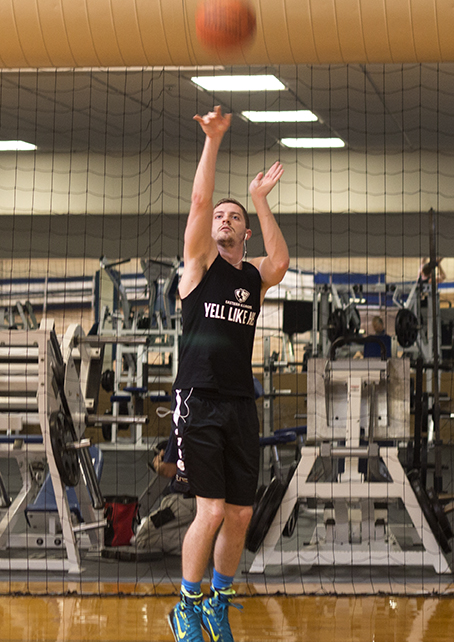 Christian Lohr shoots around with a basketball Friday afternoon at the Student Recreation Center.