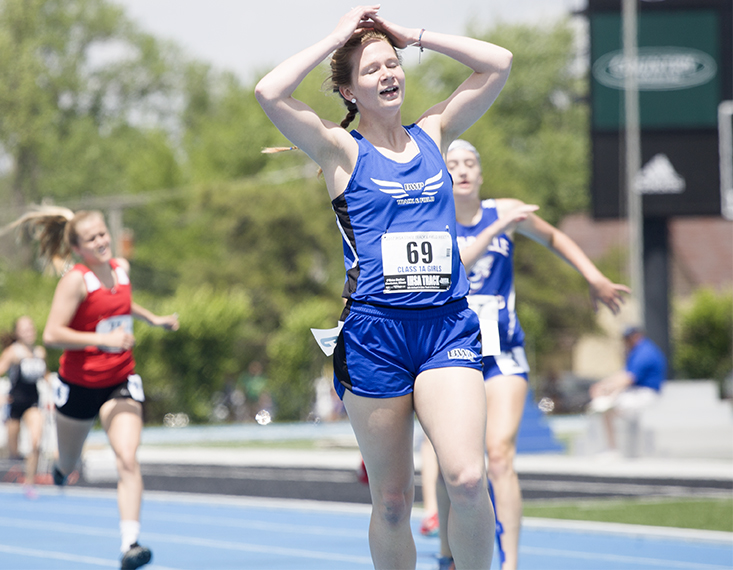 Taylor Larson, a junior from Bushnell High School, competed in class 1A and celebrates after fininishing first in the 400 Meter Dash with a time of 59.75 during thr preliminary round on Thursday. She finished fourth overall in the final round with a time of 58.14.