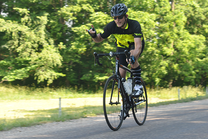 A cyclist competing in the 50-mile race races down hill near Lerna Road Saturday at the inaugural Tour de Charleston.