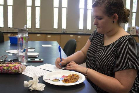 Mikayla Grant, a senior clinical lab sciences major, writes a postcard to a potential Eastern student Tuesday. Grant, who grew up in Mattoon, said Eastern has been pushed on her her whole life, but hearing about actual students' experiences made a difference to her.