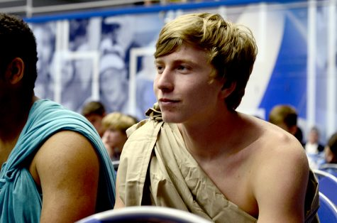 "Jacob Goertz, a rising senior from Western high school in Barr, listens to state treasurer Michael Frerichs Thursday in Lantz Arena. Goertz and his county said they decided to wear togas in order to ""stand out from everyone else."""