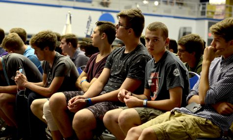 A group of high school boys sit in Lantz Arena Thursday night as they listen to a presenation by Michael Frerichs, the state treasurer, during the Illinois Premier Boys State conference.