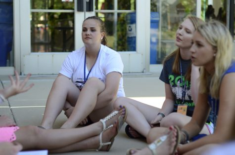 Elaina Rossman(left) and Brooklyn Whitsitt (middle), rising seniors from Knoxville High School in Knoxville Illinois, sit with Sophie Marcolla, a rising senior from Quincy Notre Dame High School in Quincy. The girls listen to and talk with their friends about the days events during the American Legion Auxiliary Illinois Girls State on Monday.