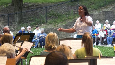 Ginger Stanfield, the director of the Charleston Community Band, conducts during the weekly concert Thursday at Kiwanis Park.