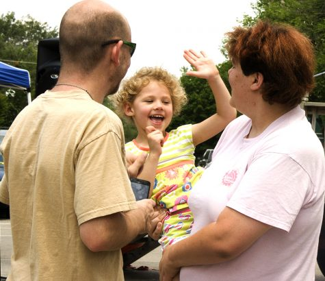 """Addison Nixon, 4, goes to high five her mom, Nicole Holt, at Musefest Saturday in the Square. Later, when asked what her favorite part of Musefest was, Nixon could barely contain her excitement as she exclaimed """"Music"""" while jumping up and down."""