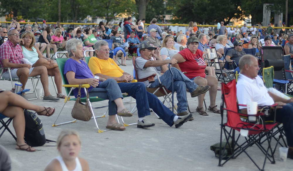 Charleston residents swarmed Morton Park Monday night to watch the Chris Lane concert as a part of the Red, White and Blue Days celebration.