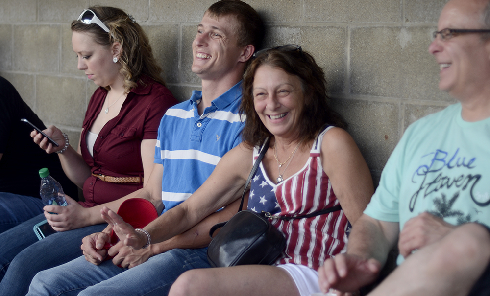 Denise Lasky laughs with Chris Dare during the Chris Lane concert Monday night at Morton Park. The concert was part of Charleston's Red, White and Blue Days.