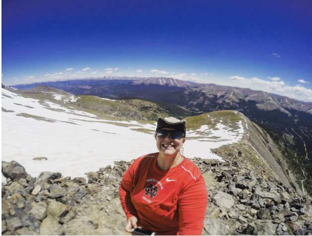 Lydia+Pond+takes+a+picture+on+Mt.+Quandary+in+Colorado+on+one+of+her+June+training+trips.+Pond+has+been+training+to+climb+Mt.+Kilimanjaro+in+August%2C+which+she+is+doing+to+raise+money+for+Parkinson%27s+disease+research.%0A