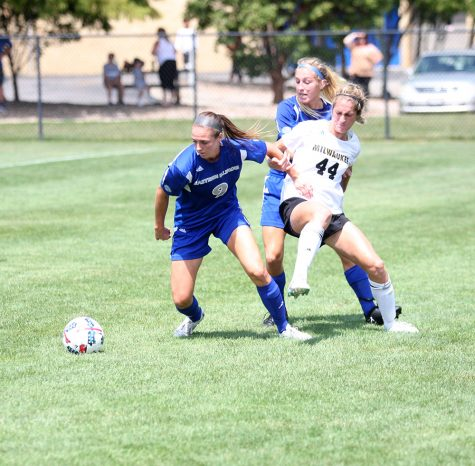 Forward Sarah DeWolf, No.9, and defender Lindsey Carlson, No.27, fight for the ball against a UW-Milwaukee attacker. The Panthers lost the Sunday afternoon game 2-0 at Lakeside Field.