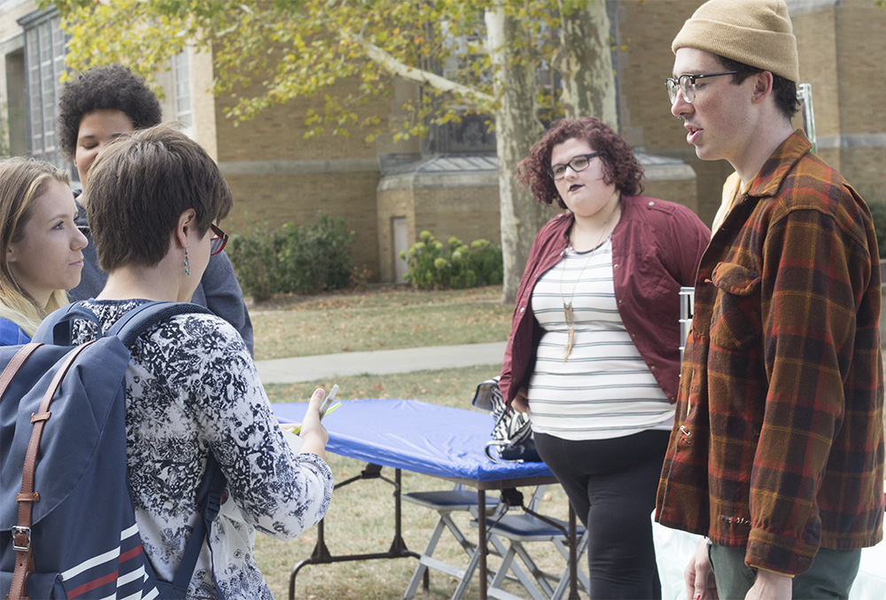 Alex Woolley (right) a 2-D studio art major, talks with students at the Fall Frolic Business Expo on the Library Quad Wednesday. Woolley said they have worked at Maurices for a year, and the Business Expo is a great opportunity for the store to reach out to the student body.