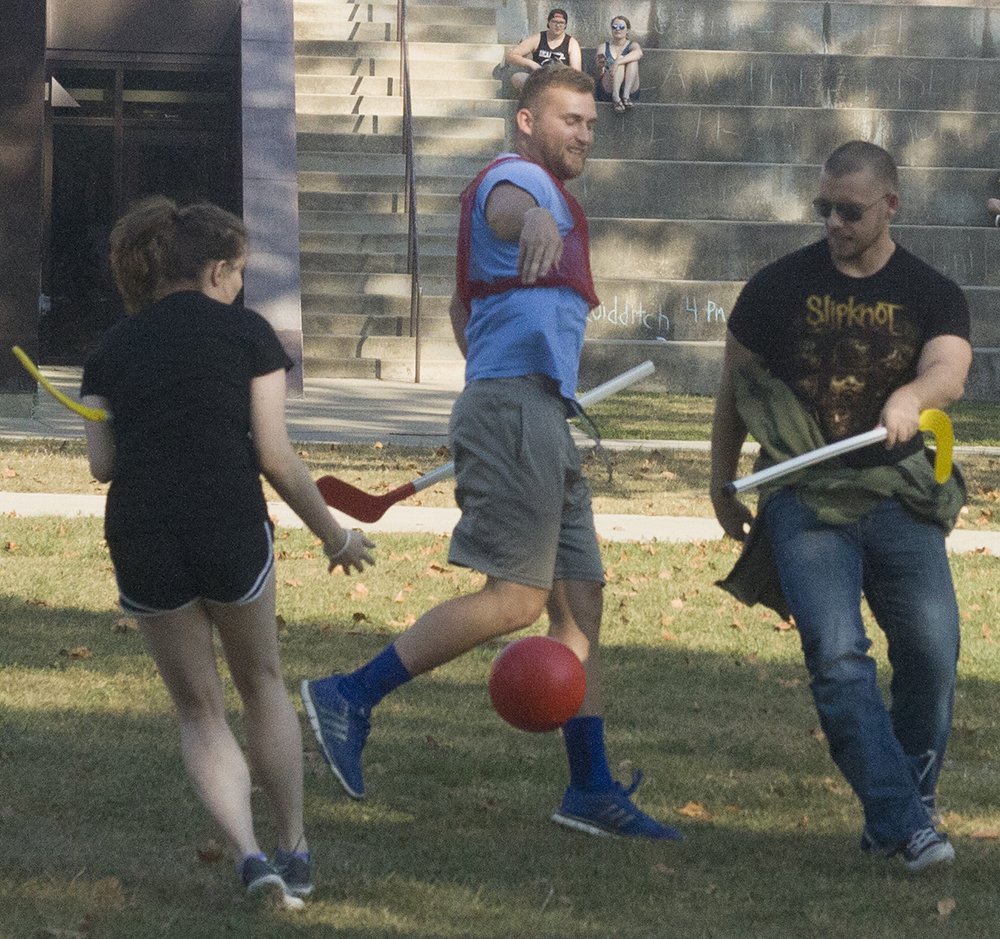 Jack Kwiatkowski, a sports management major and Jacob Hite, who was visiting Eastern for Family Weekend, play Quidditch in the Library Quad Friday afternoon. Kwiatkowski was trying to keep the other two players from getting the ball.
