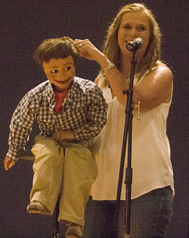 Ventriloquist Lynn Trefzger performs with her puppet Samuel in the Grand Ballroom of the Martin Luther King Jr. University Union Friday night. Samuel is the first puppet she ever used.