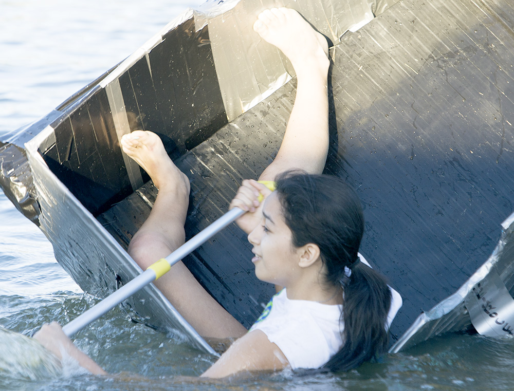 Natalie Santillan, a sophmore elementary education major, tries to stay afloat in her boat for Taylor Hall in the Rocfest boat races at Campus Pond. Santillon eventually lost the battle and ended up in the water.