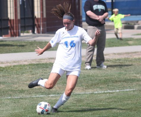 Eastern's Kayla Stolfa strikes a ball in a game against Chicago State where she set the single-game record for assists with four. Eastern won the game 5-1 at Lakeside Field .