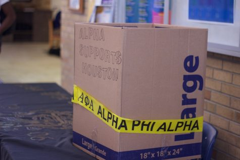 """""""Alpha support Houston"""" is written on the box that sits on Alpha Phi Alpha fraternity's donation table. The fraternity was collecting toiletry items for victims of Hurricane Harvey on Wednesday, Sept. 20 in the Martin Luther King Jr. University Union."""