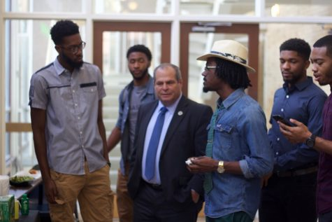 President David Glassman talks with members of Alpha Phi Alpha while the members prepare to help get more donations.