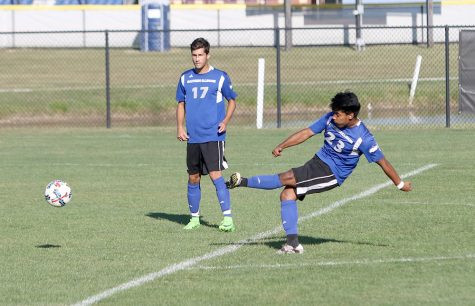 Sophomore Jonathan Huerta sends a free kick toward the goal in the Panthers' 1-0 against Saint Francis Sept. 10 at Lakeside Field.