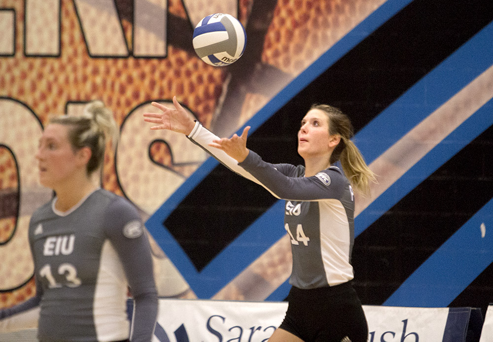 Sophomore setter Gina Furlin tosses the ball up for a serve Wednesday against Edwardsville.
