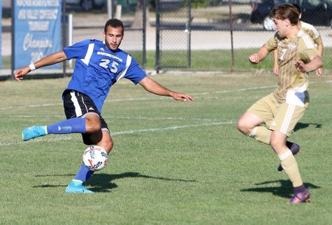 Freshman Shady Omar attempts to kick the ball away in the Panthers' 1-0 win over Saint Francis Sept. 10 at Lakeside Field. The Panthers play at Western Saturday.