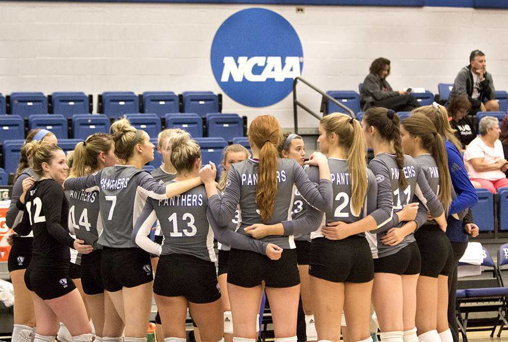 The volleyball team gathers for a huddle after the first set of Wednesday's game against Southern Illinois-Edwardsville.