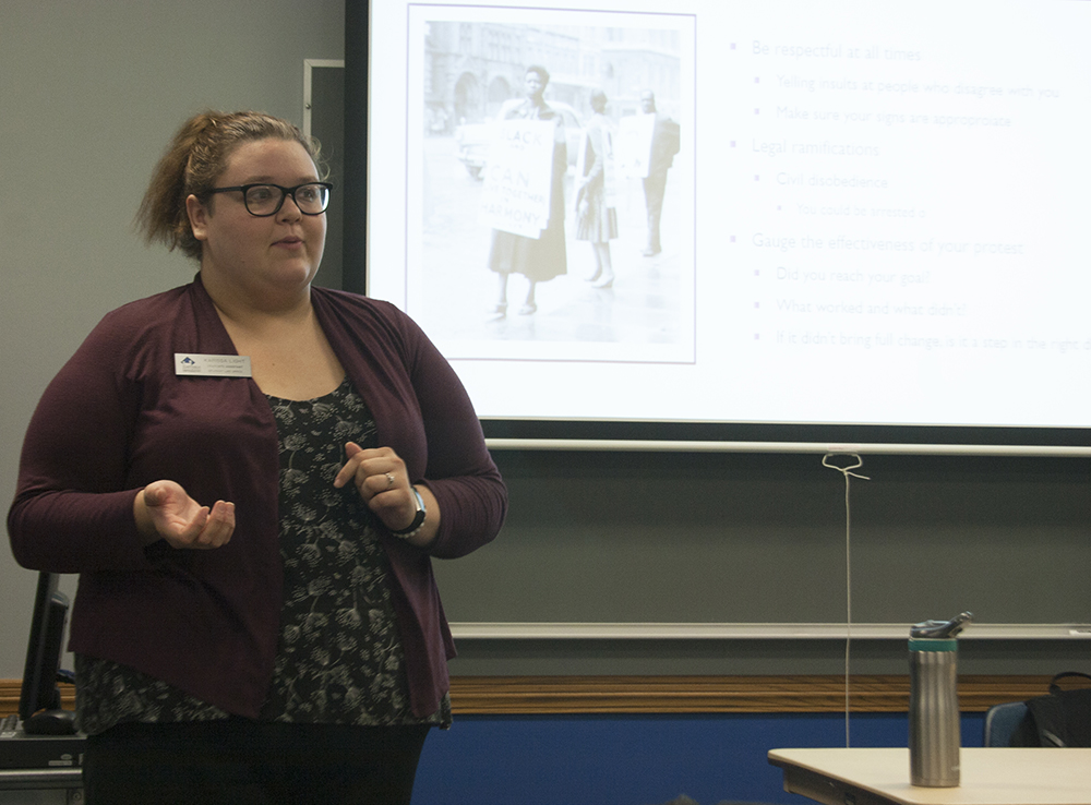 Karissa Light, an intern with the Center for Gender and Sexual Diversity, teaches students how to be an activist for various causes at Activism 101 Wednesday night in the Martinsville Room of the Martin Luther King Jr. University Union.
