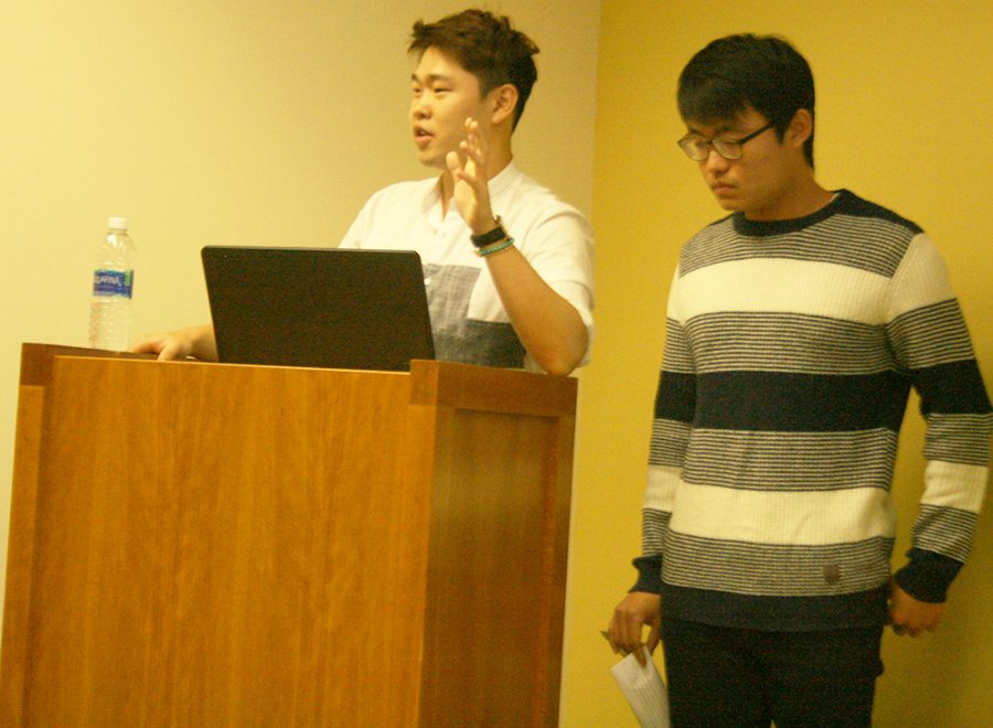 "Sungkwan Park, (left,) president of the Korean Student Association and Seonghwan Kim, secretary of the Korean Student Association, give their presentations on the issues between North Korea and both South Korea and the U.S. at a talk called ""Dotard"