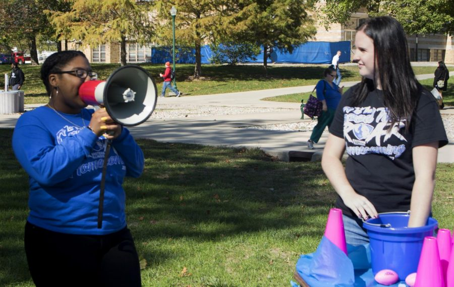 "Emonie Jordan (left), a senior kinesiology and sports studies major and the Homecoming Kickoff Activities co- chair, and Caroline Chrzanowska (right), a senior early childhood education major and the other Homecoming Kickoff Activities co-chair, call out raffle numbers at ""Rumble in the Jungle"" Monday afternoon in the Library Quad. ""I think this was a great idea, I think the execution of it was perfect,"" Jordan said. ""I think what we have right now is really great, a lot of people are having fun. They're staying to play the games, and they're staying to win prizes."""