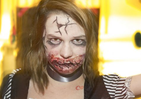 Grace Osborn, a student volunteer actor for the Pemberton Hall Haunted House, dressed up as a scary doll on Saturday night. Osborn said she did her own makeup for the event.