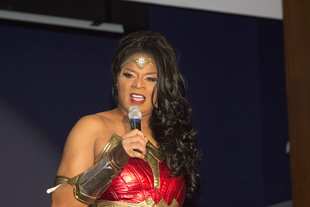 """After performing, Drag Queen Ceduxion Carrington thanks everybody for coming out to the Halloqueen Drag Show event Monday evening held in the Grand Ballroom in the MLK Junior University Union. """"Drag is about entertainment, not orientation."""" Ceduxion Carrington said."""