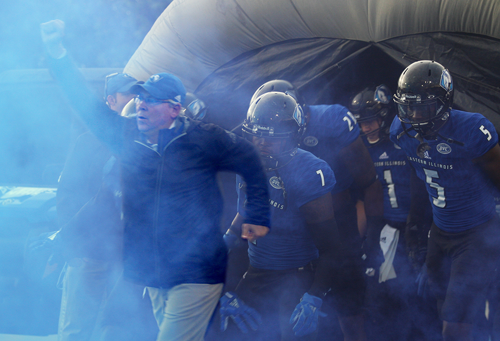 Eastern football coach Kim Dameron leads the Panthers out of the tunnel prior to their game with Tennessee Tech. Eastern won 24-23.