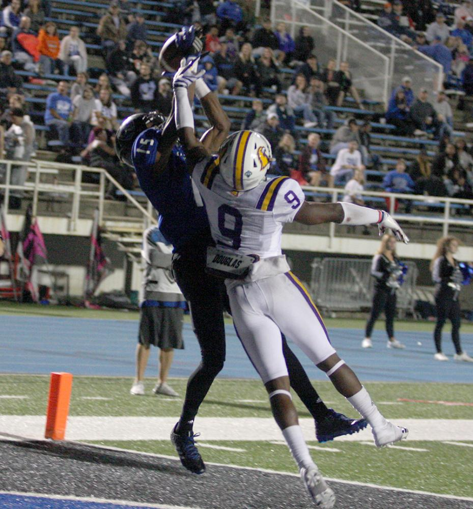 Junior receiver Alexander Hollins goes up and catches the pass from Bud Martin for a touchdown in the Panthers' 24-23 win. Hollins had three touchdowns.