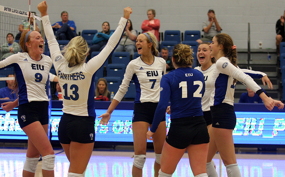 Allie Hueston (9), Maria Brown (13), Taylor Smith (7), Anne Hughes (12), Madison Cunningham, Laurel Bailey (far right) celebrate a point in the Panthers' 3-0 win over Tennessee Tech Friday in Lantz Arena. Eastern won two matches this weekend.