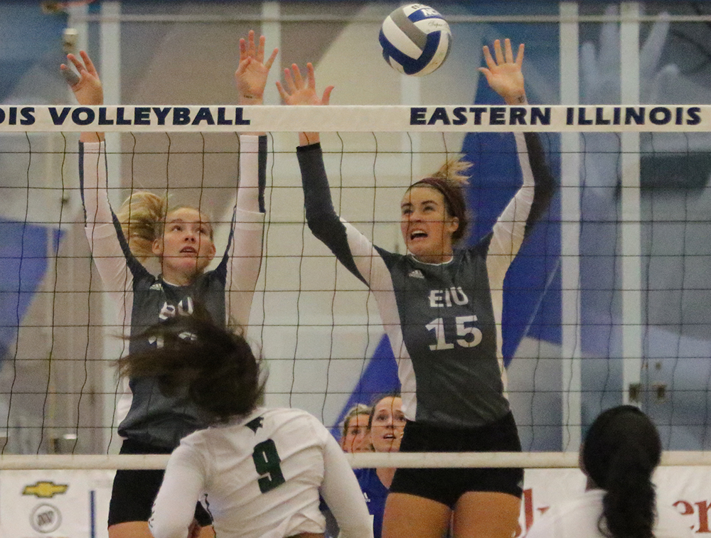 Laurel Bailey and Maggie Runge go up for a block in Eastern's game against Chicago State on Sep. 9. The Panthers lost the match 2-3 at Lantz Arena.