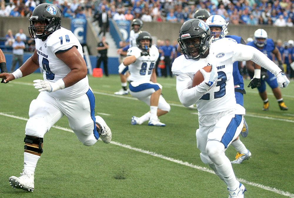 Junior running back Isaiah Johnson rushes in a touchdown against Indiana State Aug. 31 in Terre Haute. Eastern hosts Tennessee Tech this weekend for the Hall of Fame game.