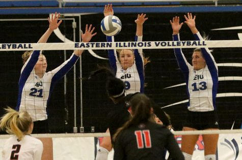 Freshman Lexi May (left), senior Allie Hueston (middle) and senior Maria Brown go up for the block against Austin Peay's attack. The Panthers lost in straight sets friday in Lantz Arena.