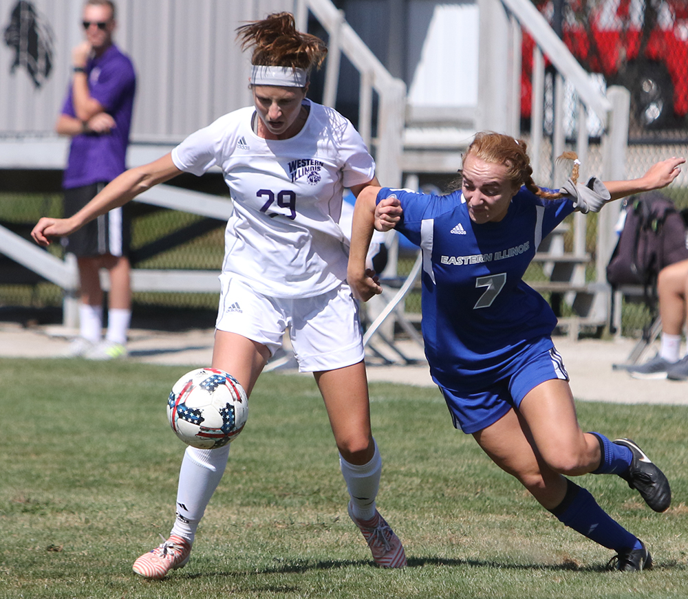 Eastern's Caitlin hawley fights for a ball with Western Illinois' Alexandra Siavelis in a game on Sep. 10. The Panthers won the game at Lakeside Field 2-1.