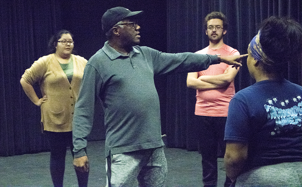 Ron Himes, director and founder of the Saint Louis Black Repertory (center), rehearses with students at the Black Box located in the Doudna Fine Arts Center Monday night.