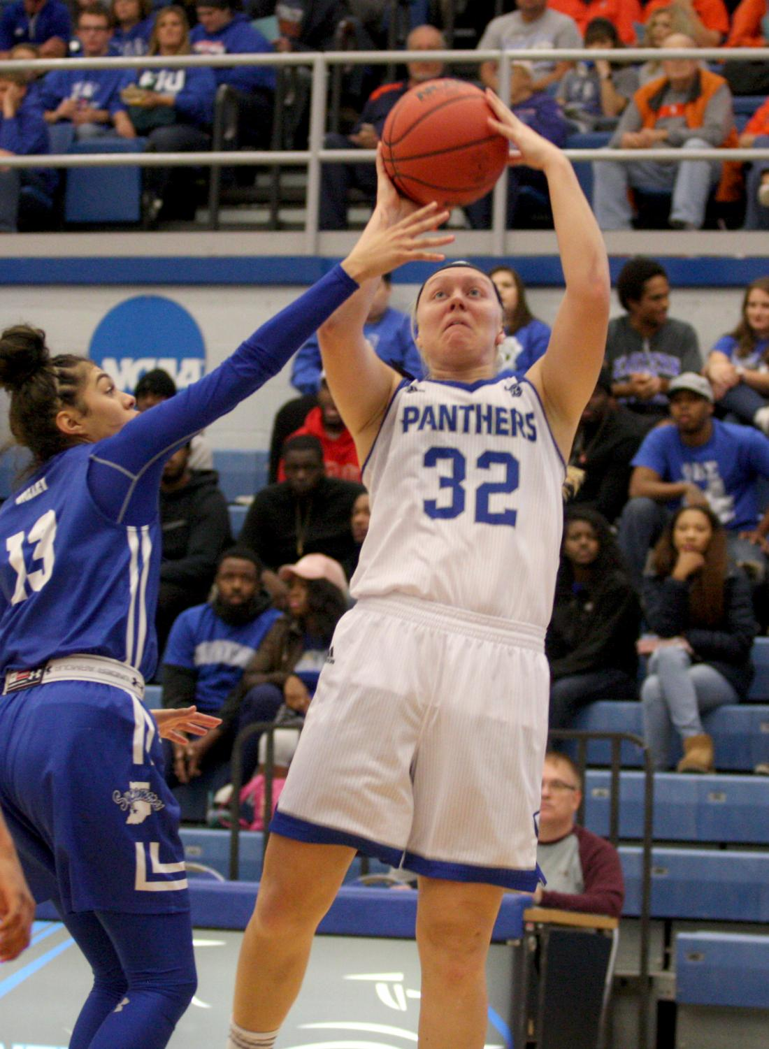 Sophomore Jennifer Nehls goes up for the layup in Eastern's win over Indiana State. She had 9 points and 7 rebounds.
