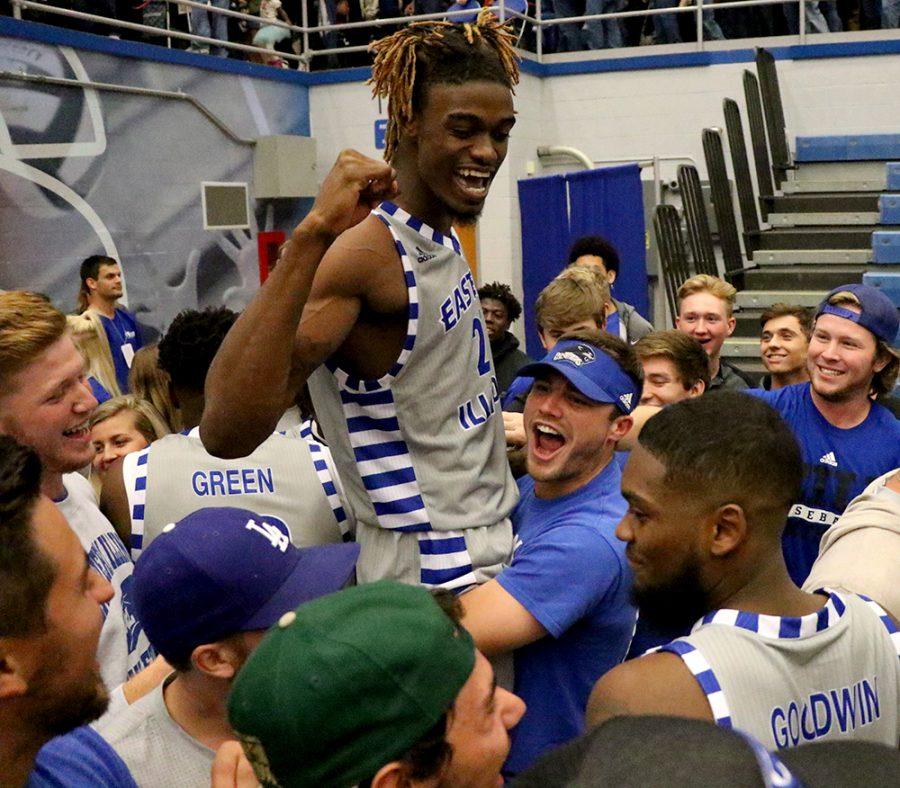 Senior Muusa Dama celebrates the mens basketball teams win over the University of Illinois Friday in Lantz Arena. Dama had 14 points in the win.