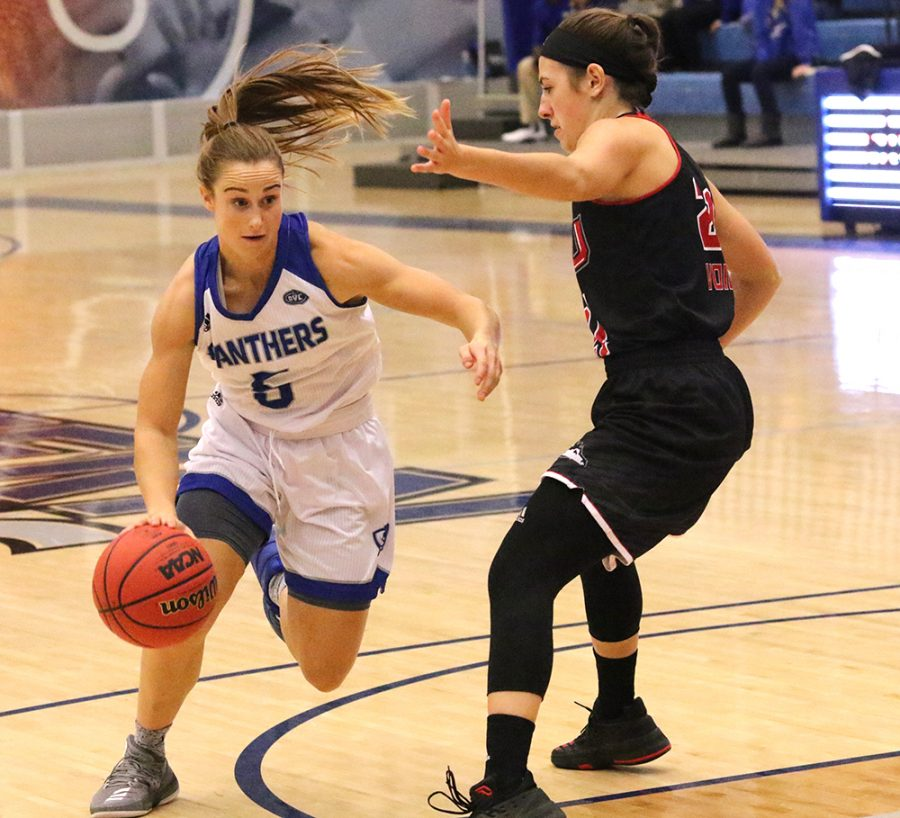 Grace Lennox drives toward the hoop against a Northern Illinois defender. The Panthers lost 93-64 Friday night at Lantz Arena.