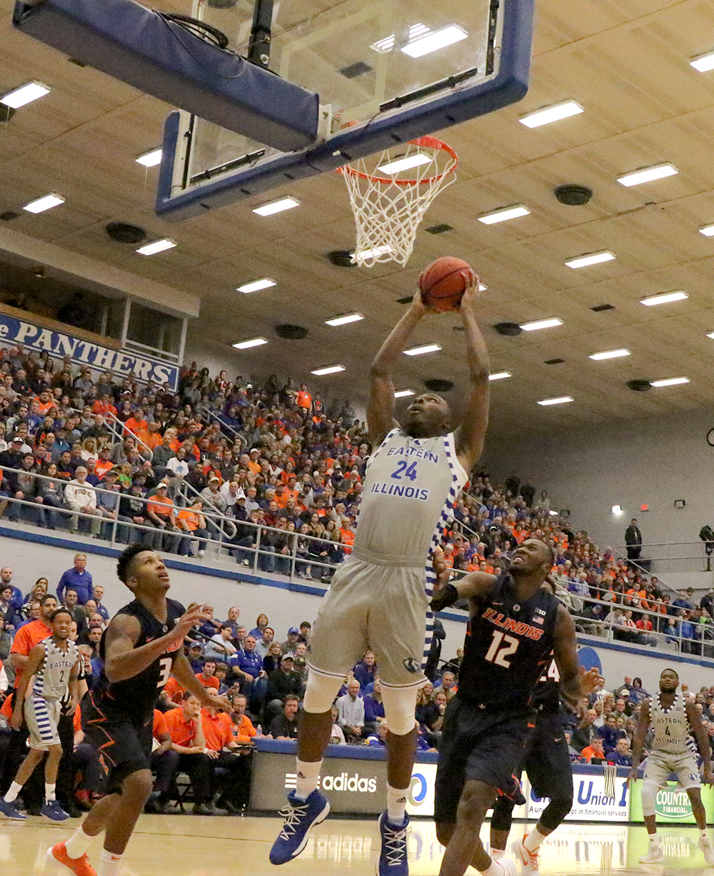 Junior Jajuan Starks goes up for the dunk in Eastern's win over Illinois Nov. 3 in Lantz Arena. Starks is the Panthers' leading scorer and said they need to get better at closing out games.